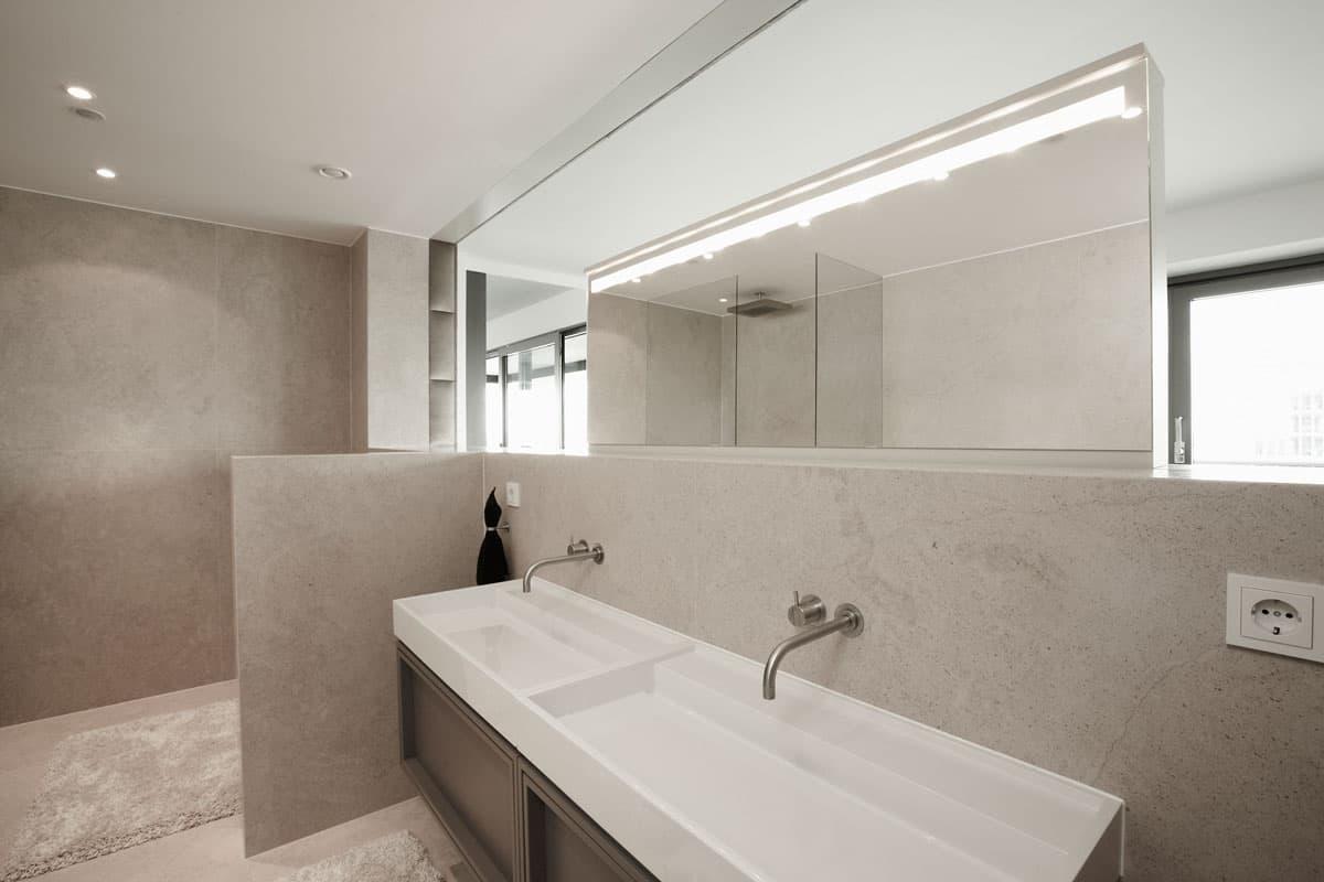an oversized shallow bathroom lavatory punctuates the warm wood custom bath vanity by eggersmann