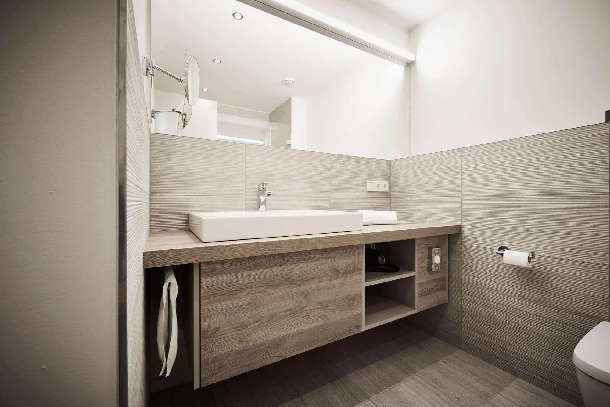 bathroom vanity and wall storage custom designed and installed by eggersmann