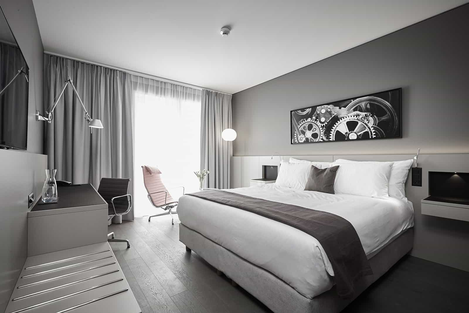 moody gray bedroom with storage and custom furniture designed by eggersmann