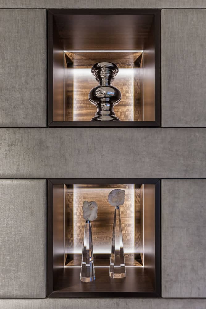 art niches designed into a stone wall by eggersmann