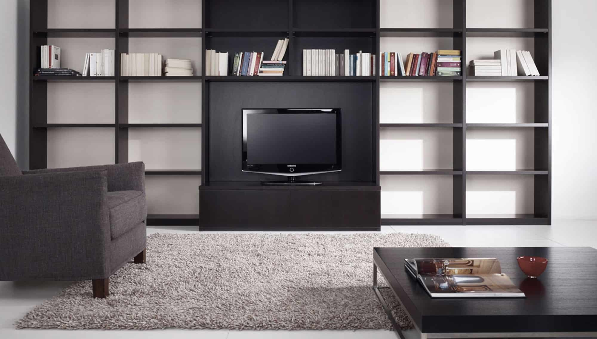 modern library wall and custom designed furniture by eggersmann