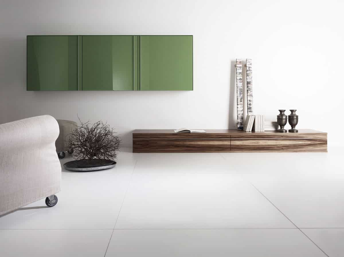 uber-modern white room of eggersmann-designed furniture punctuated with a green laminate clad wall cabinet