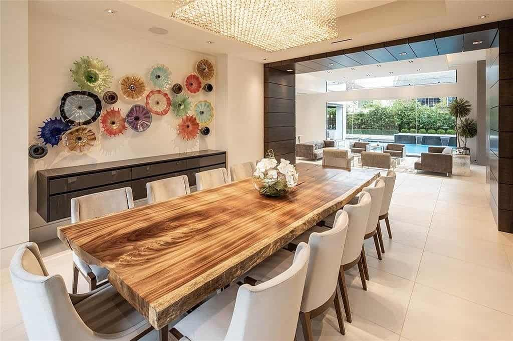 dining room with oversized rough hewn natural edge plank table and eggersmann floating credenze