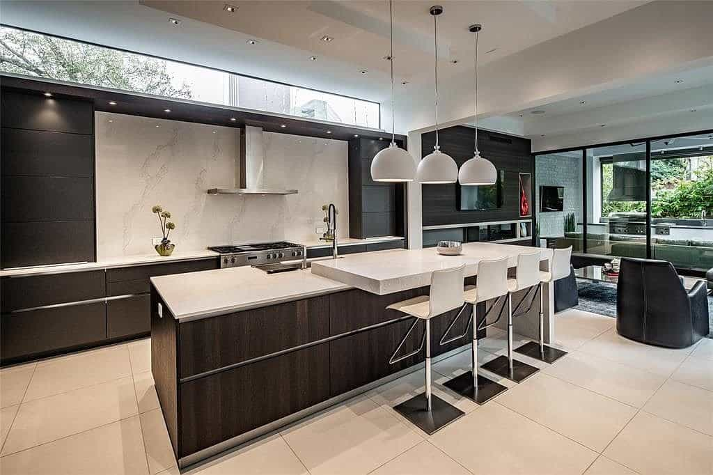 eggersmann kitchen island with dining countertop and miele stovetop