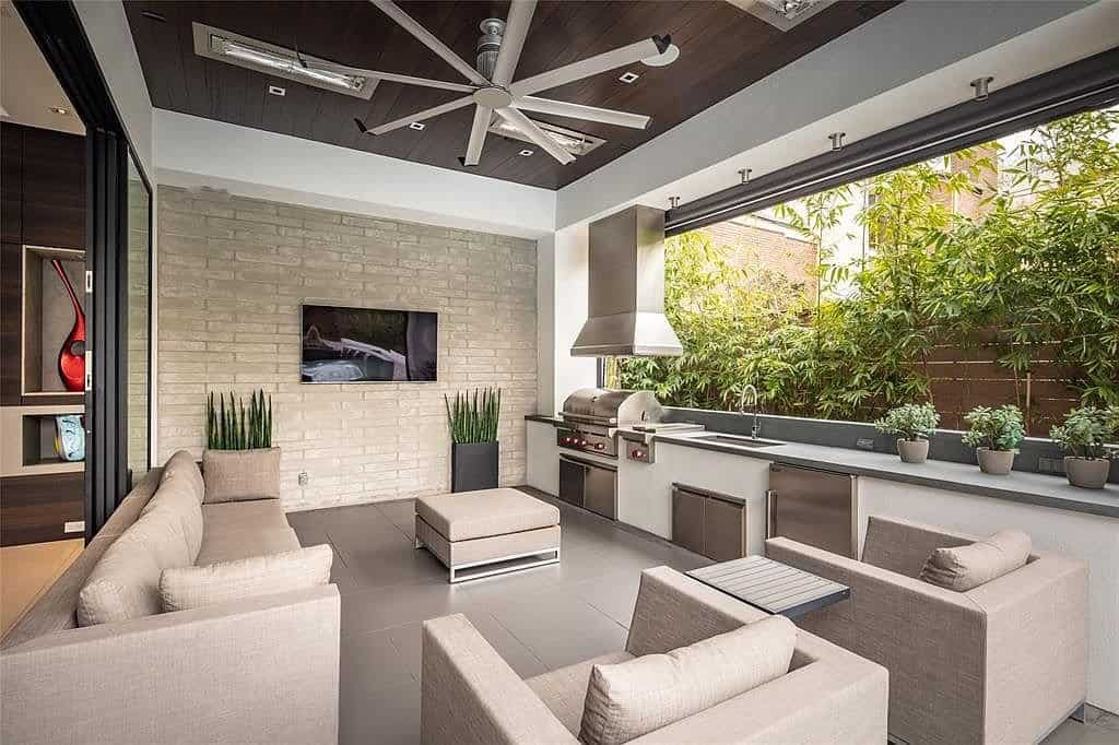 outdoor kitchen and lounge expands entertaiing and relaxing opportunities of this tanglewood home