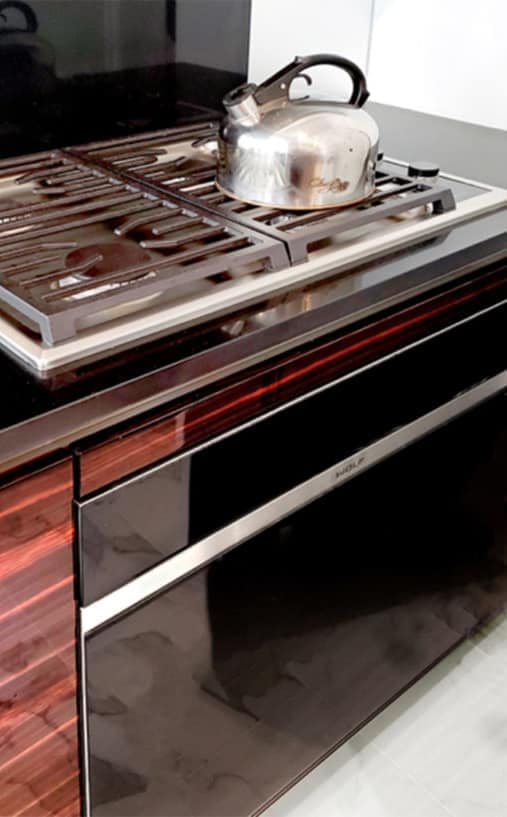 high-end wolf stove in luxury kitchen designed by eggersmann