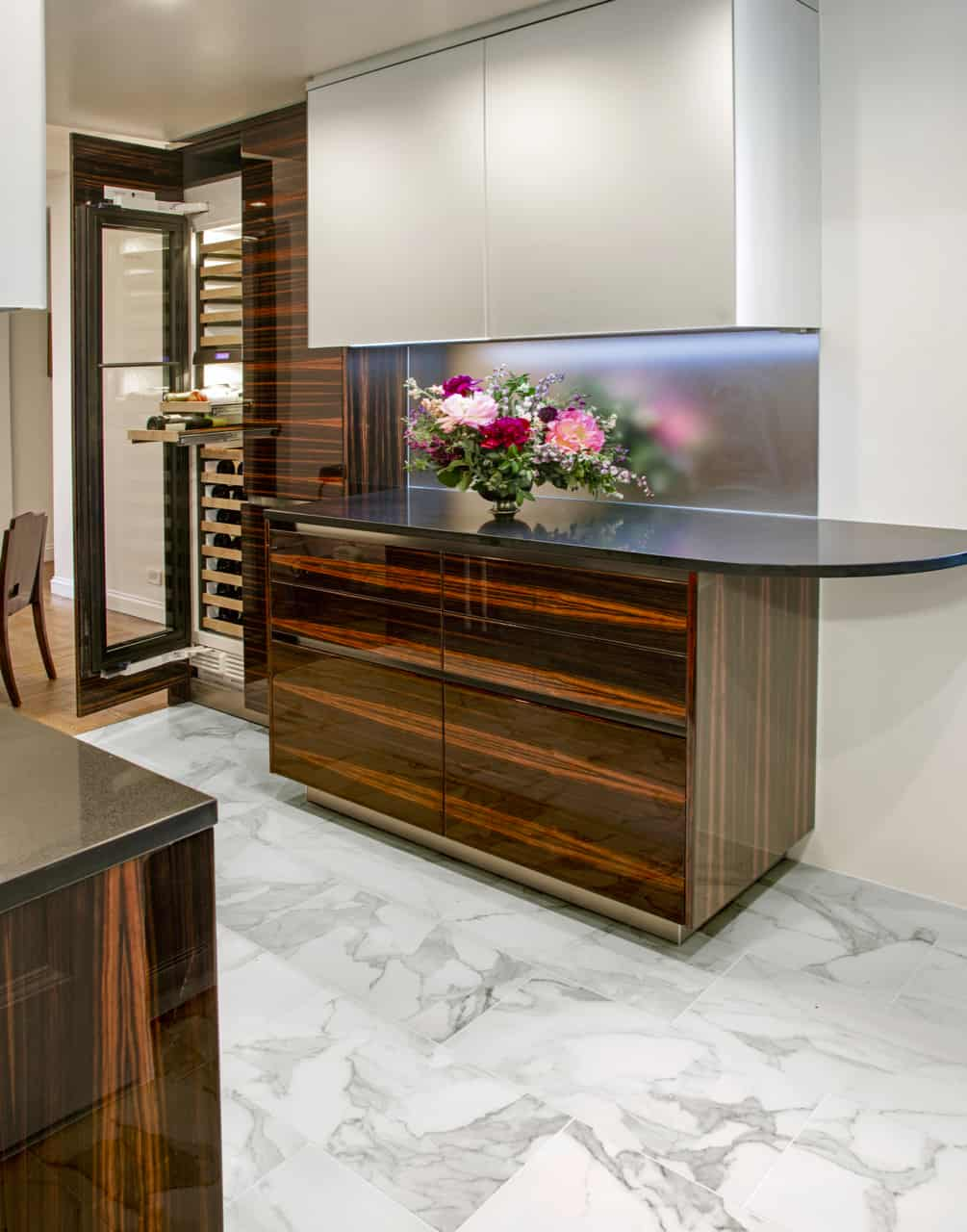 maccassar ebony cabinetry in high gloss finish with white mirror finish upper cabinets