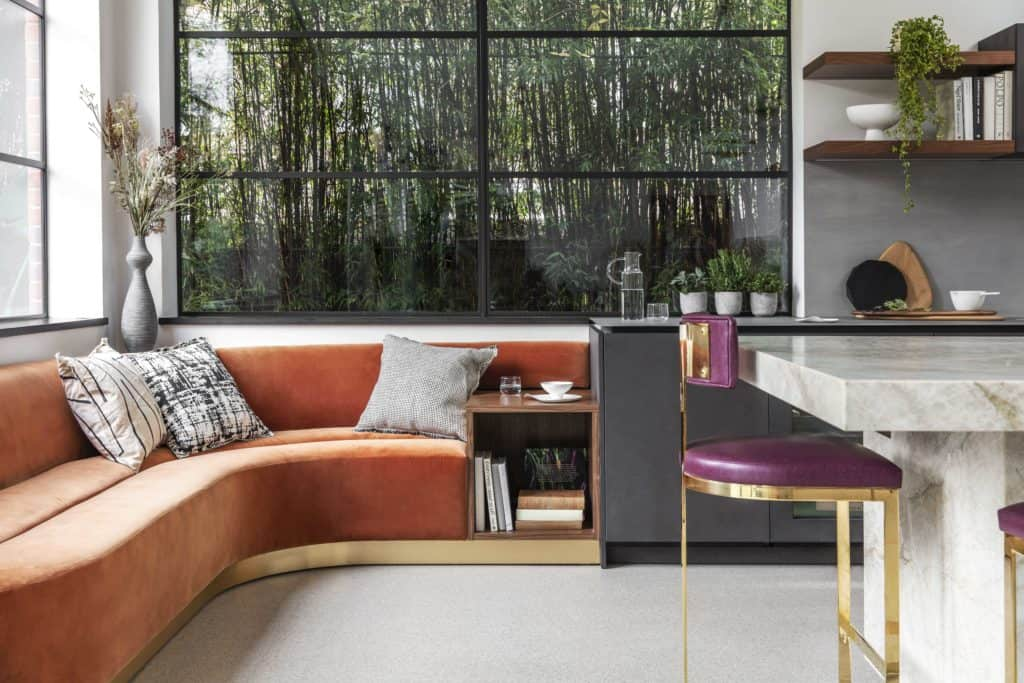 burnt orange lounging banquette in bespoke kitchen by eggersmann which is part of the project nominated for sbid international design award 2019