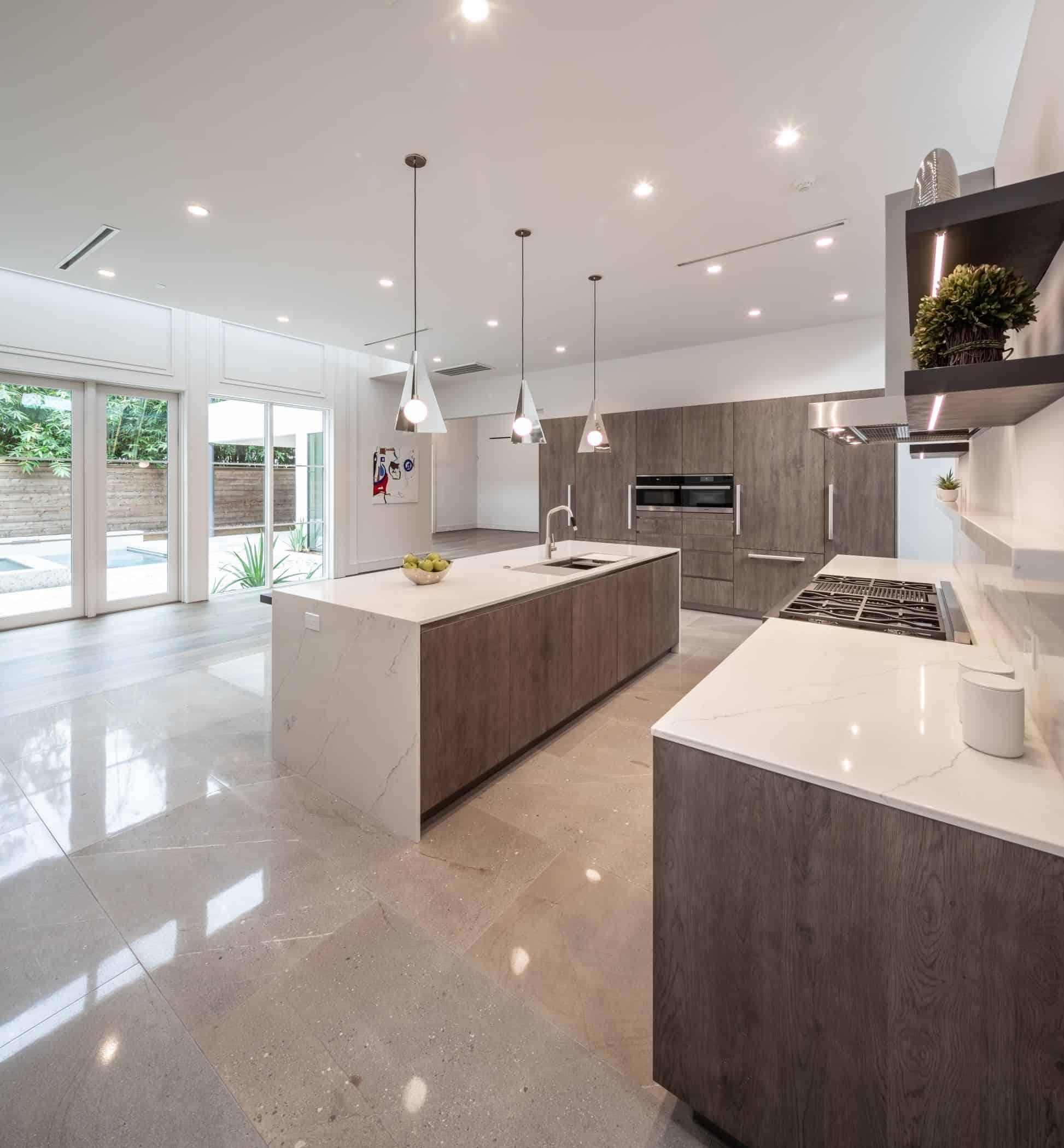 ultra modern kitchen by eggersman in a washington coalition memorial park area home in houston