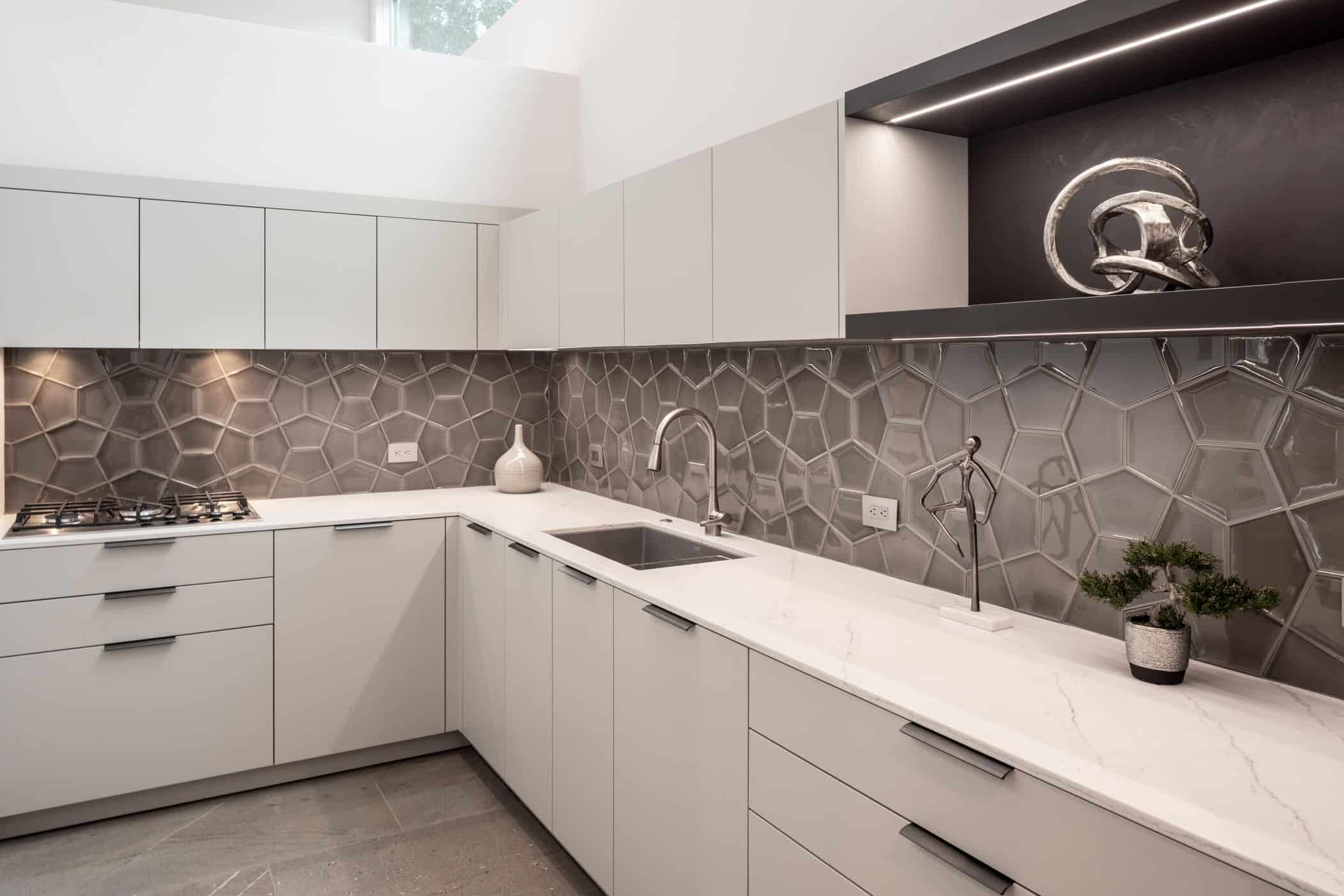 eggersmann german cabinetry and oversized mosaic backsplash in a washington memorial park area home in houston
