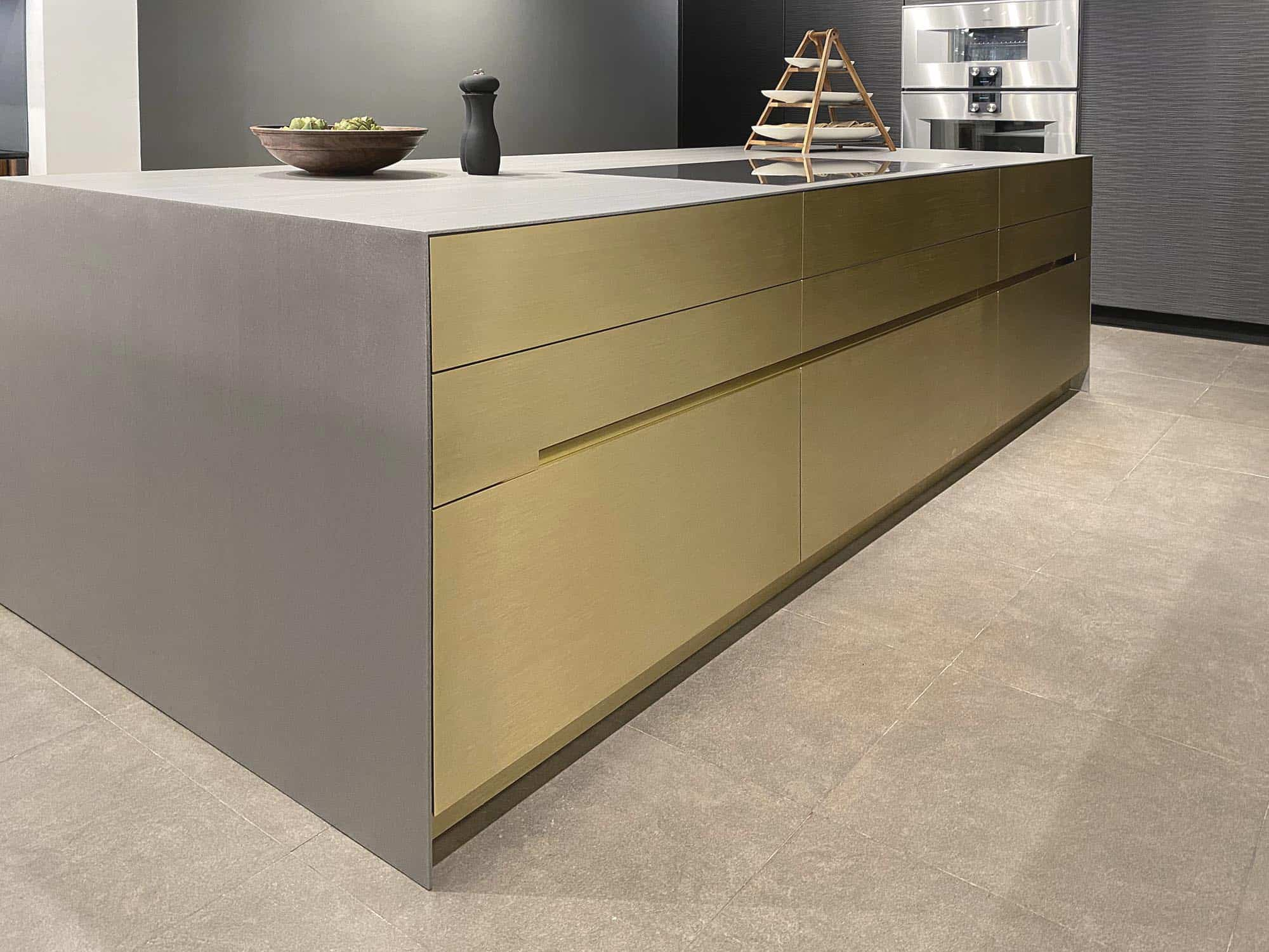 handlefree kitchen island in silvertouh hot rolled steed in a new kitchen display in the eggersman NYC showroom