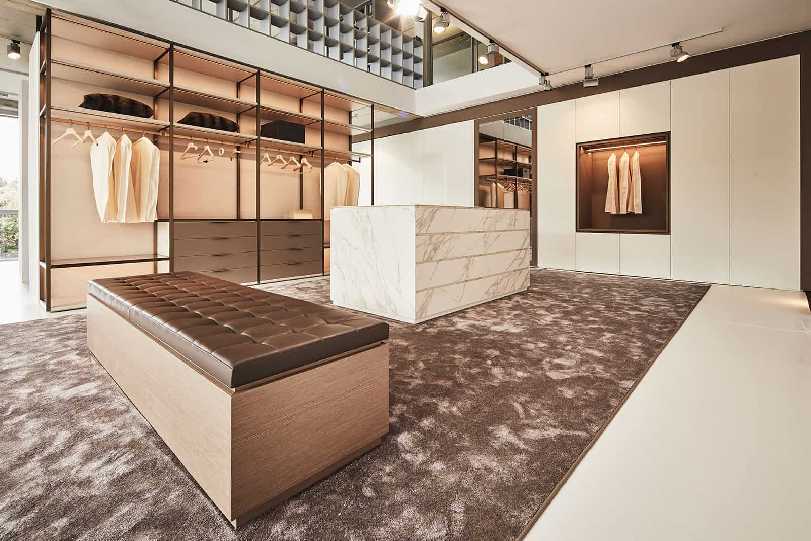 modern bespoke walk-in closet with leather, stone, and wood accents custom luxury walk-in closet by schmalenbach designed by eggersmann