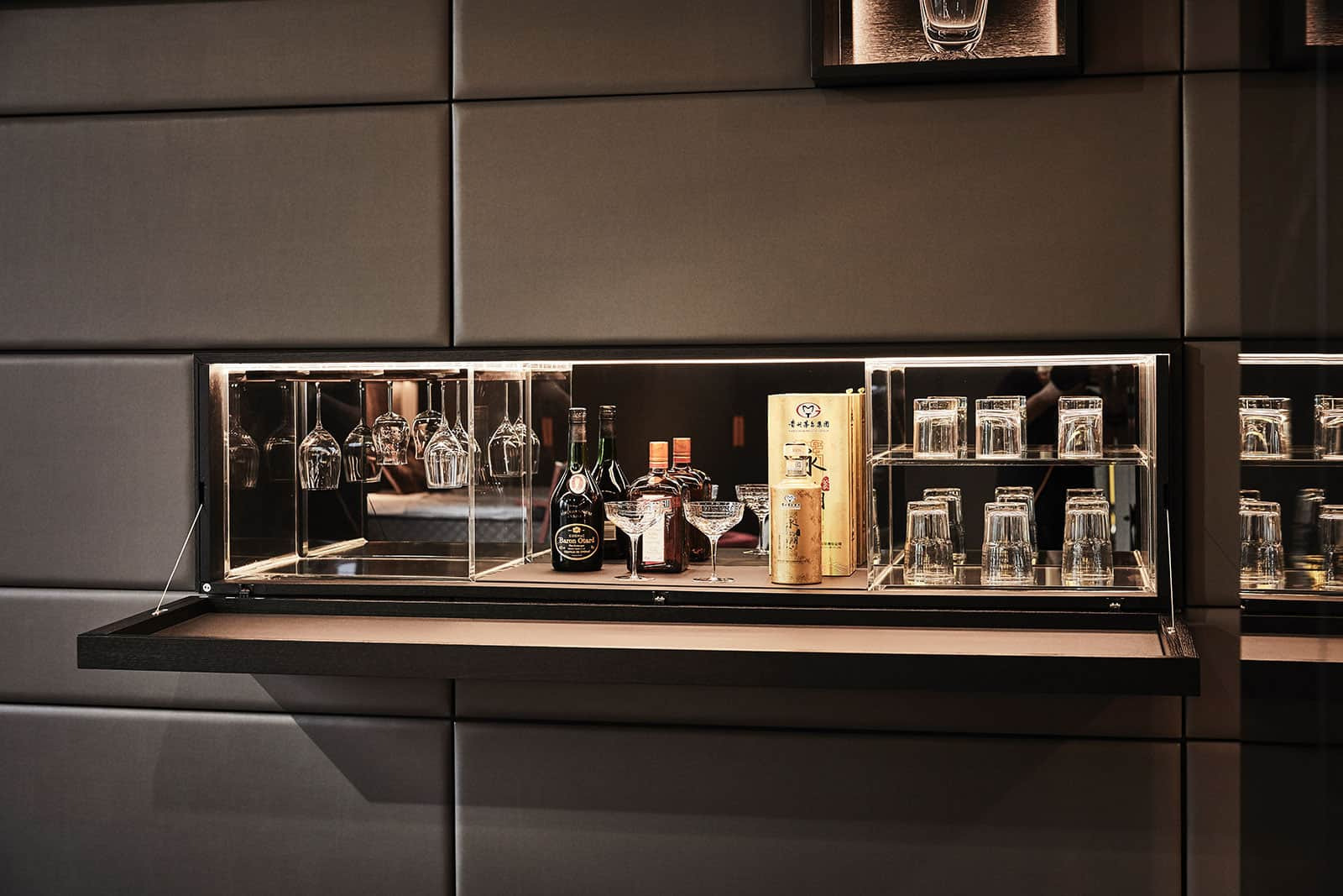 hideaway bar in a custom-designed living room wall of german cabinetry designed by eggersmann