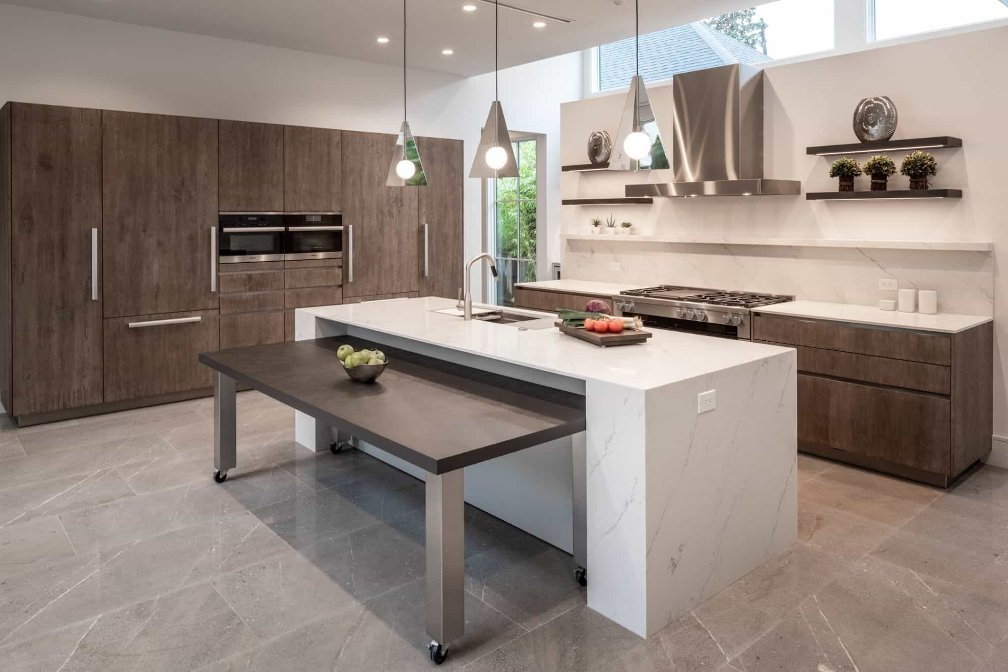 A custom nesting table in this chic german-built kitchen is the perfect answer to a flexible space-saving design