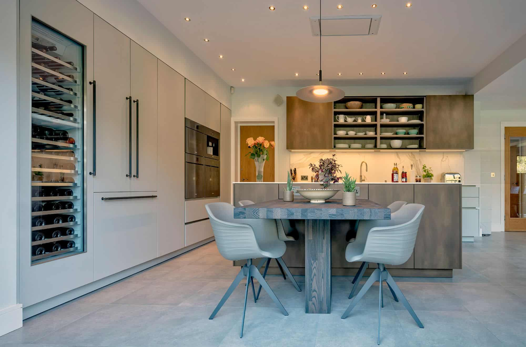 warm, inviting, and modern small kitchen with built-in dining table