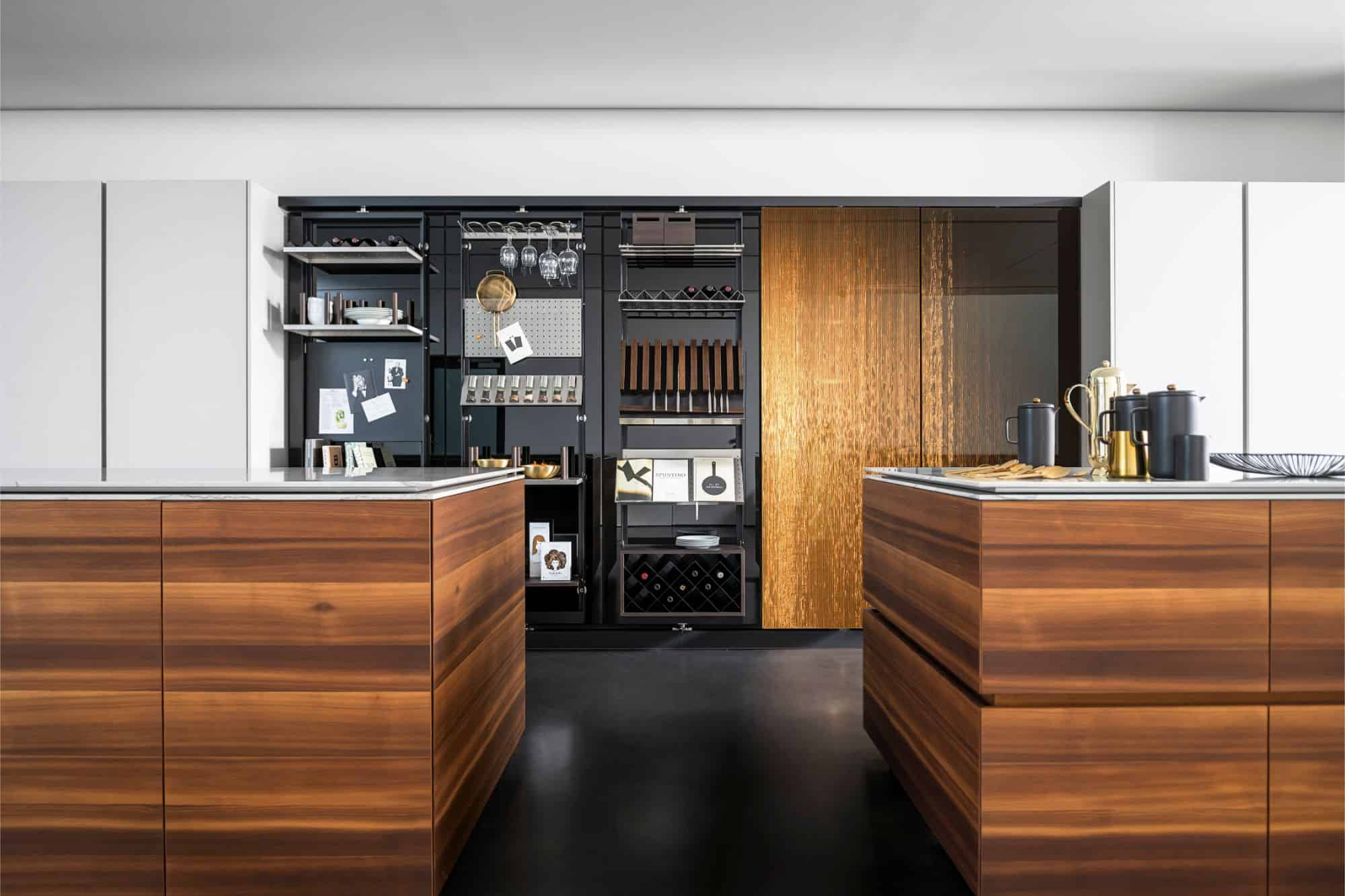 dual island kitchen in warm woods and interlink bronze finishes