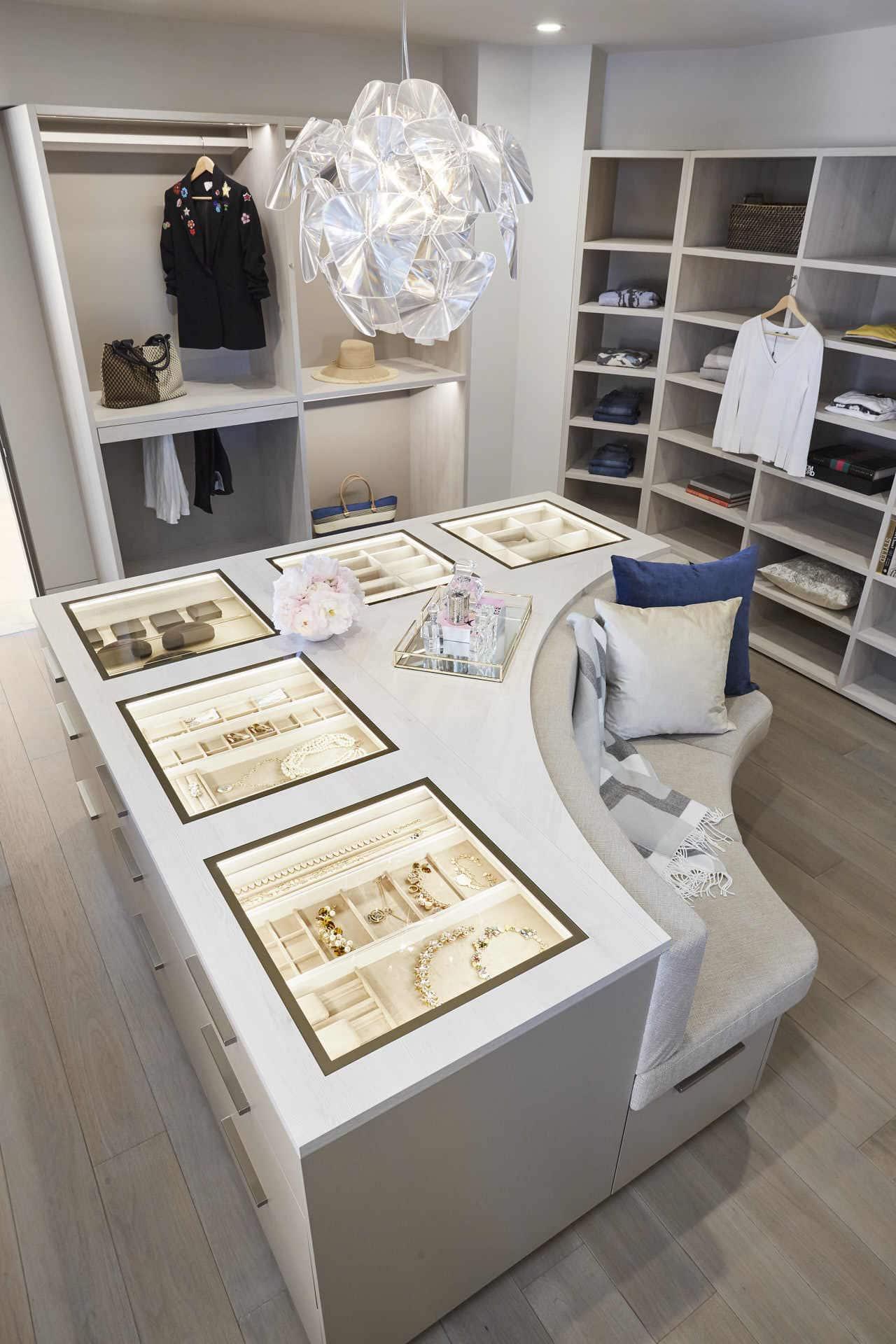 bespoke lined jewelry display case in an island of a bespoke walk-in wardrobe