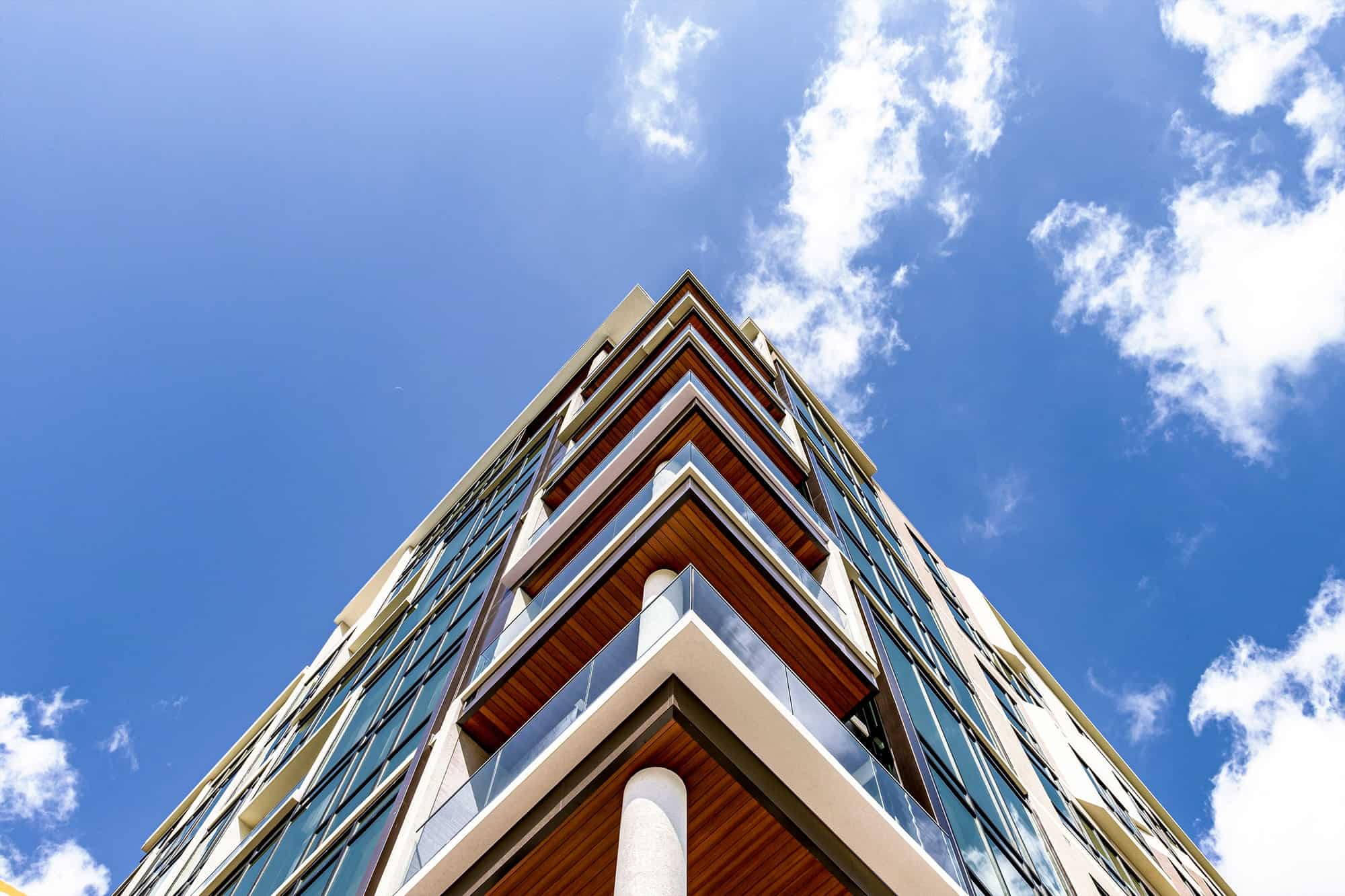 corner of the facade of the mondrian luxury apartments in hermann park of houston