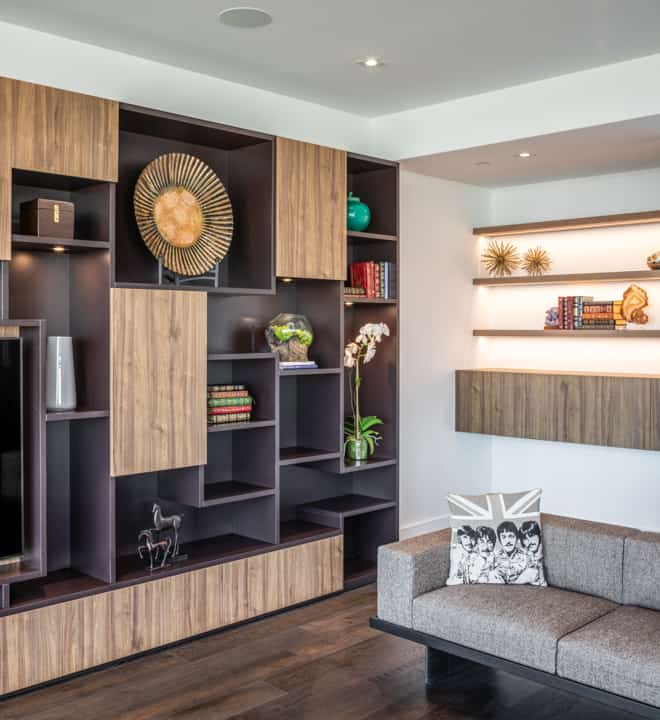custom media unit for art display and practical storage in unit 601 at the mond luxury condos