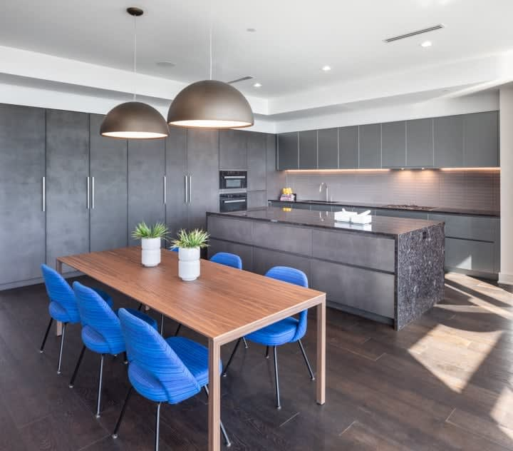 dining space and luxury stone kitchen in unit 601 at the mond luxury condos