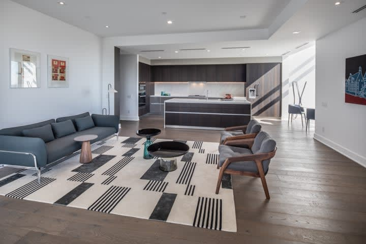 ultra-modern kitchen and living area of in the condo unit 730 of the mond at the museums