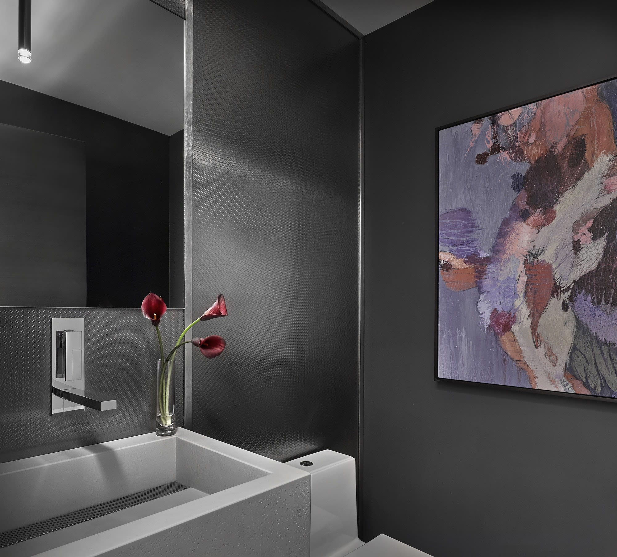 dark gray tone-on-tone design is perfect for a dramatic powder room