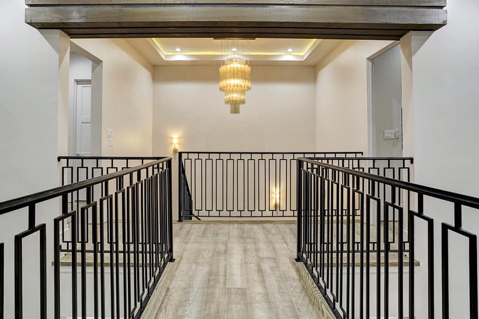 example catwalk and landing installation of Chateau Malbec flooring used in eggersmann-designed condos in The Parklane Houston