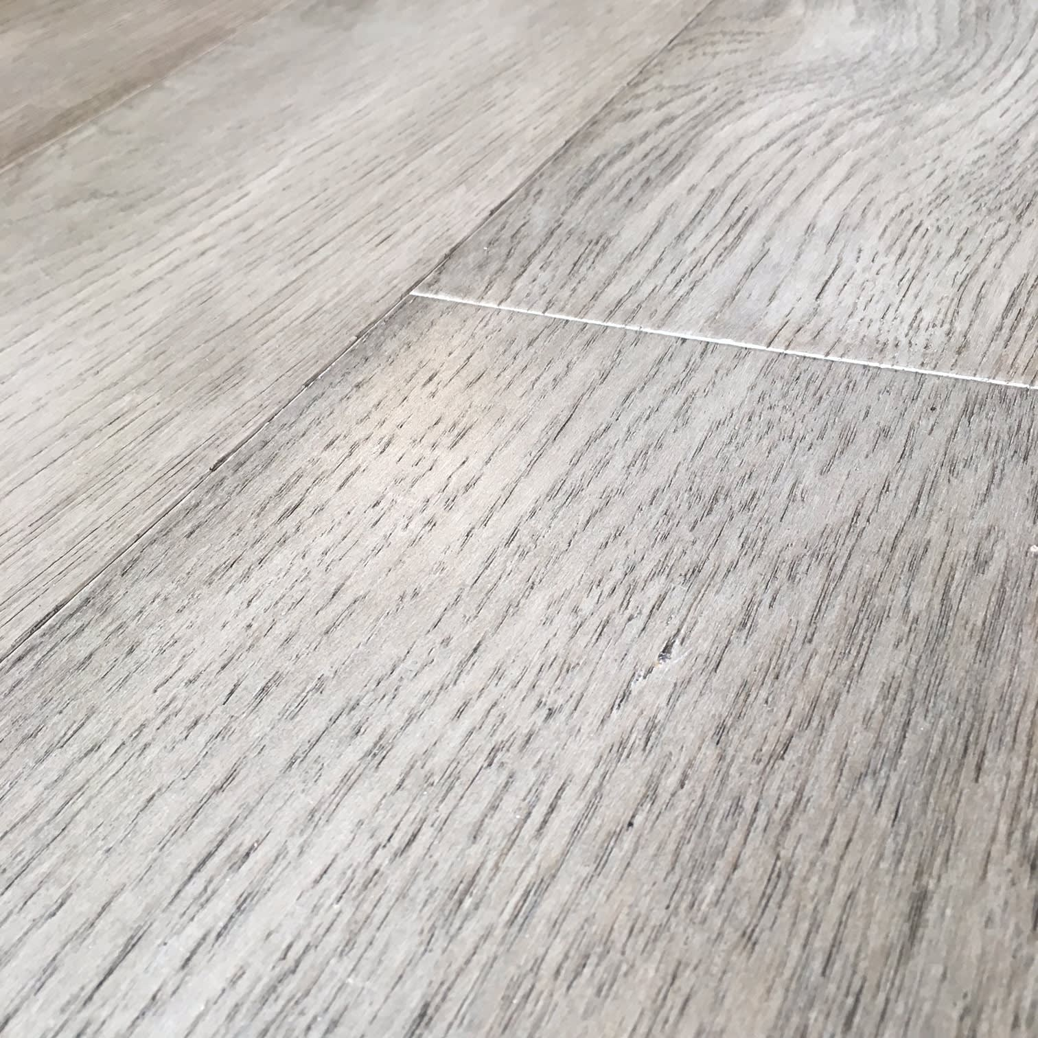Detail of high quality wire-brushed finish on Chateau Malbec flooring used in eggersmann-designed condos in The Parklane Houston