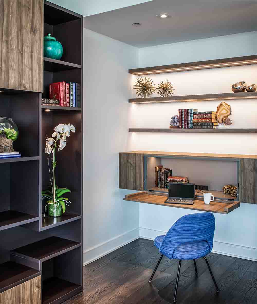 led lighting accents the design of these slim floating shelves and the hideaway desk as well as illuminating the desktop