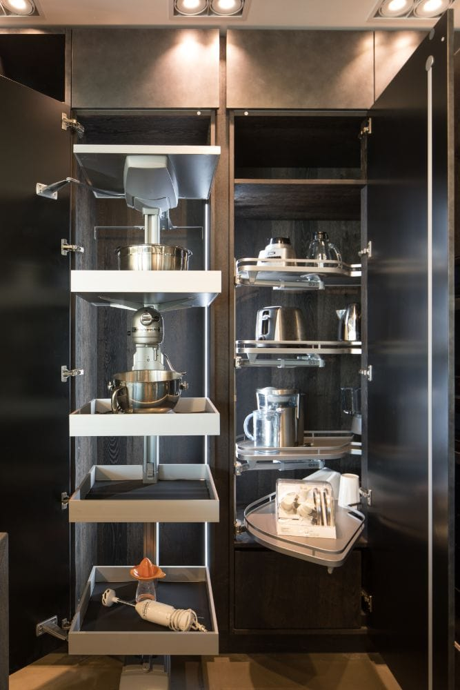 led lighting throughout pantry shelving makes it easy to find the right appliance or food item