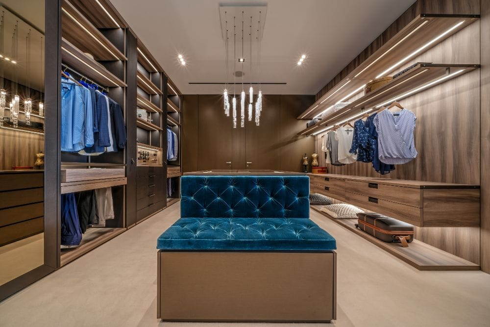 led lighting throughout this luxury walk-in wardobe accentuate the collection of fashion and make getting dressed easier