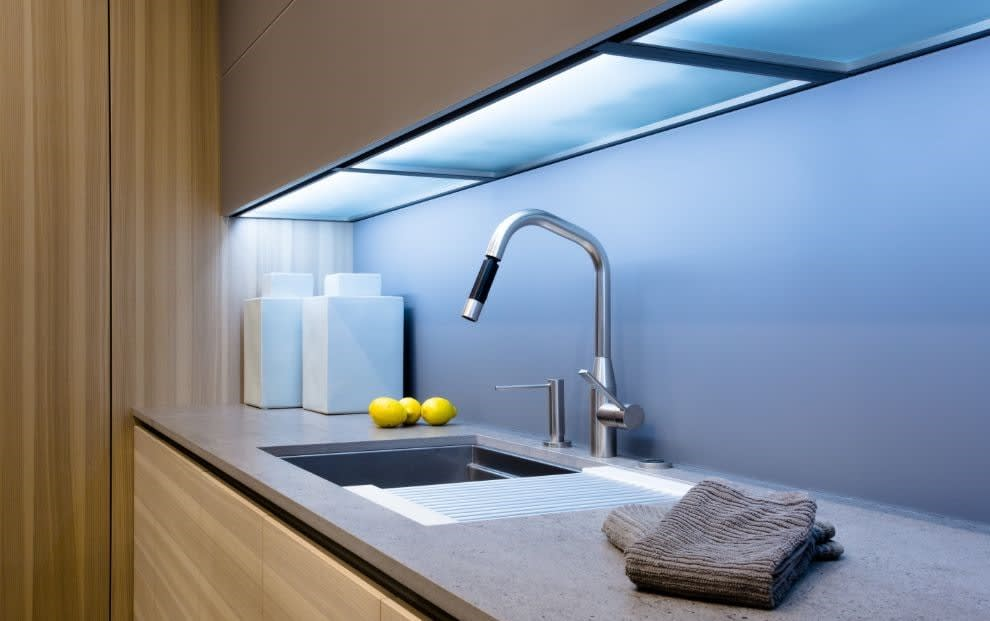 sleek under-cabinet led lighting gives the perfect glow to this luxury bar sink