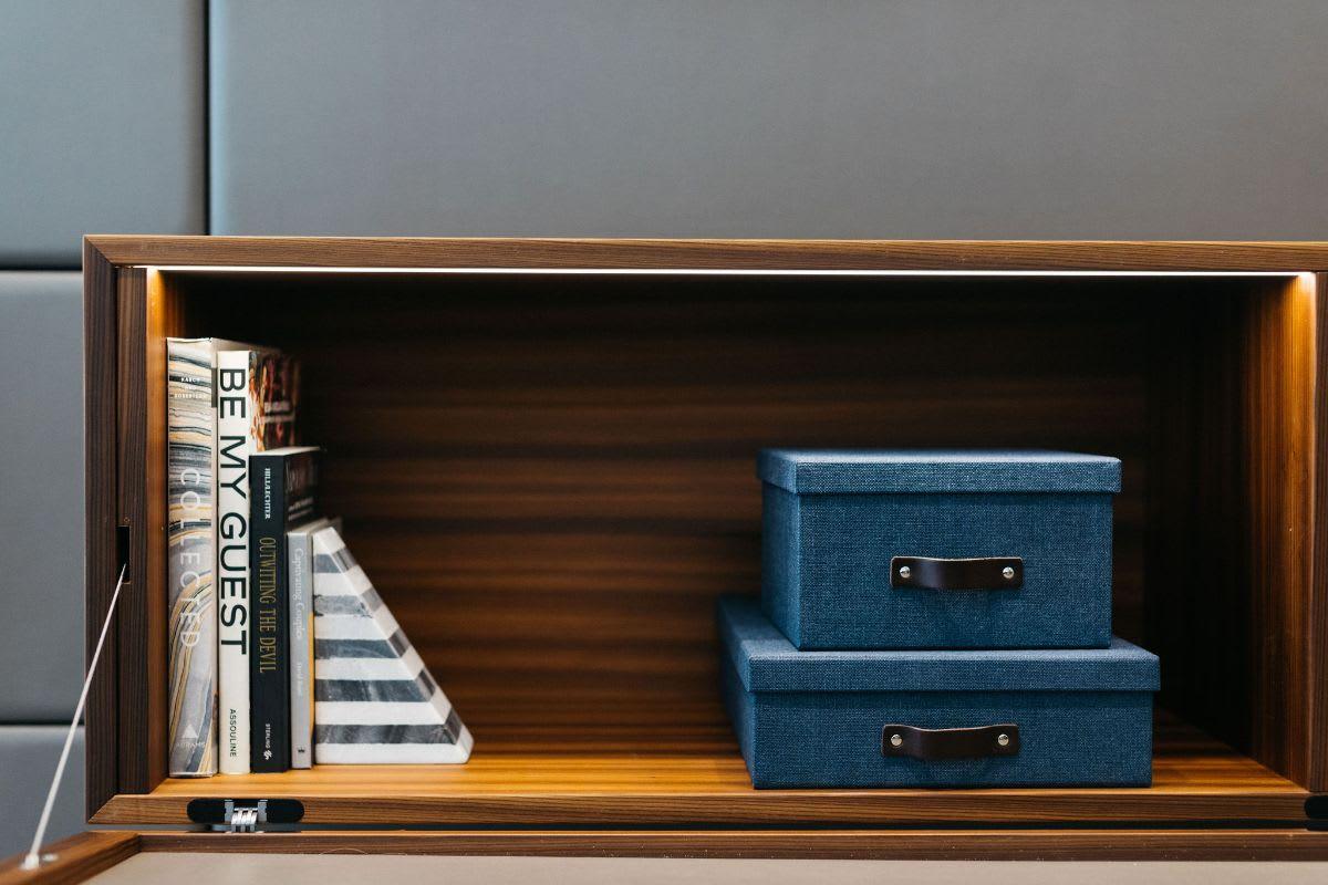led lighting inside hidden storage cabinet on a media wall unit designed by eggersmann