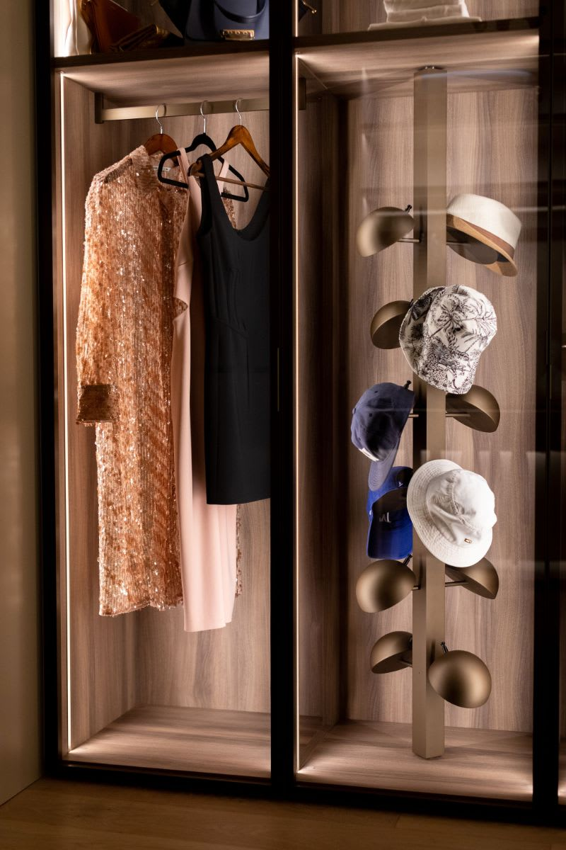 overhead and side lighting using led highlights a collection of haute couture formawear and hat collection