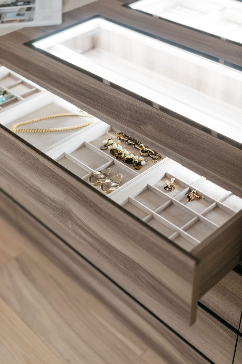 interior LED lighting in a jewelry caase in a luxury walk-in closet designed by eggersmann