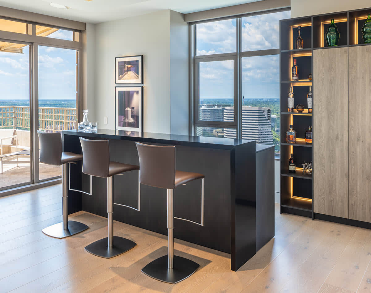 high-end compact kitchen in a high-rise featuring eggersmann's sydney range of metal finishes