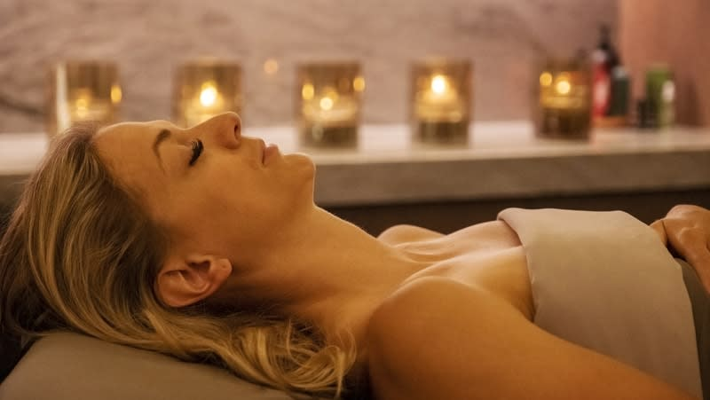 woman relaxing in the tahoe beach club spa in a massage room