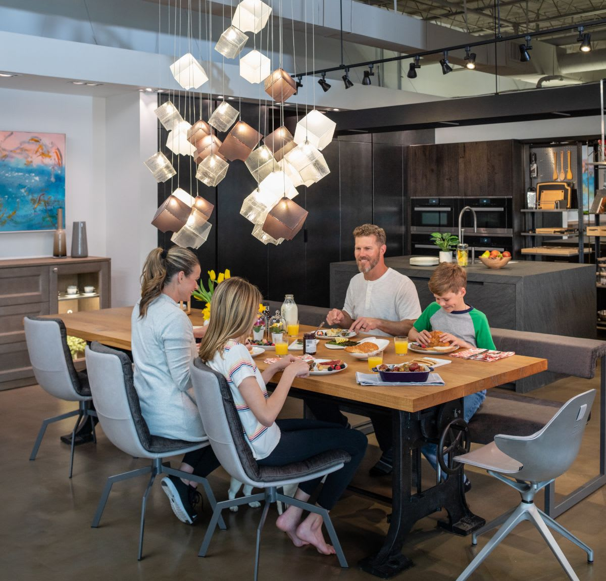 family eating a home-cooked meal in luxury dining chairs custom-designed by eggersmann