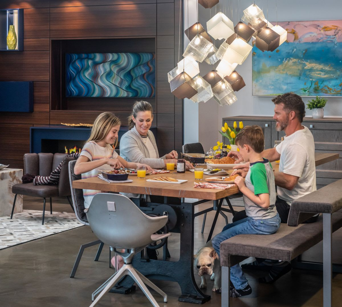 family eating around a custom dining table with chairs by eggersmann