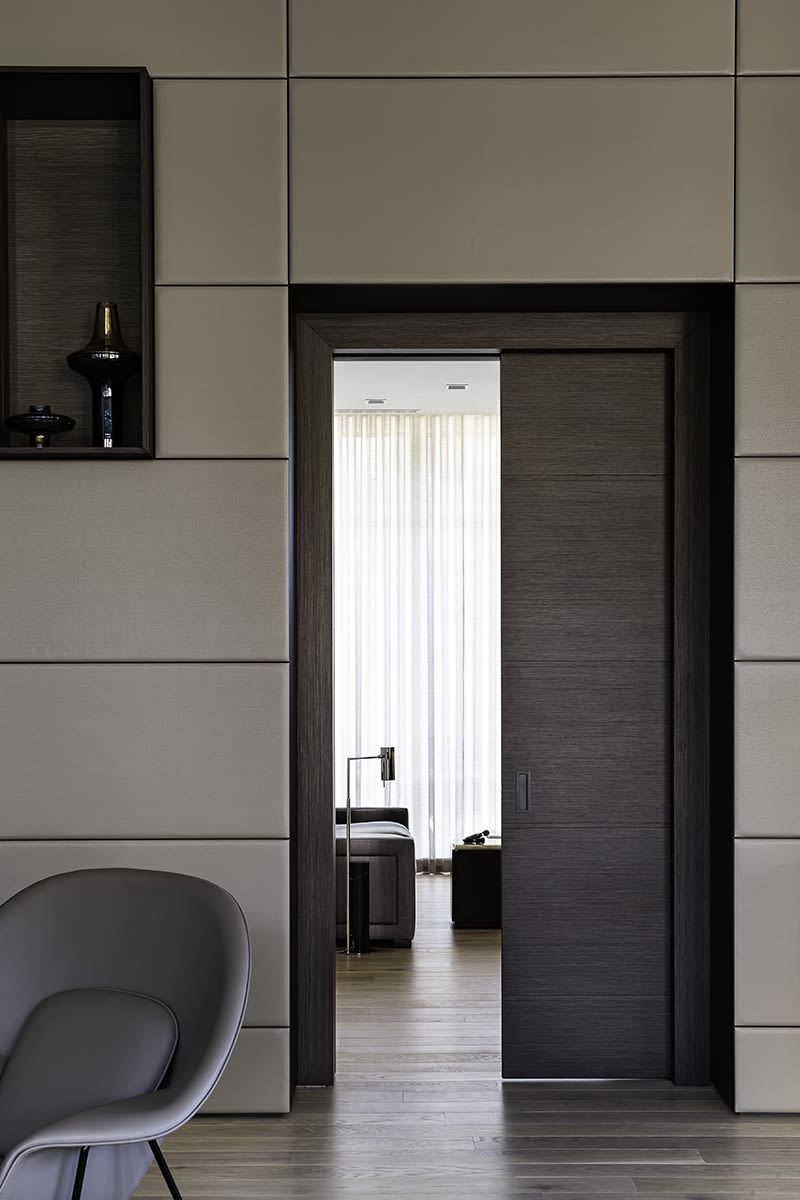 pocket door from great room to bedroom of a southwest contemporary kitchen designed by eggersmann dallas