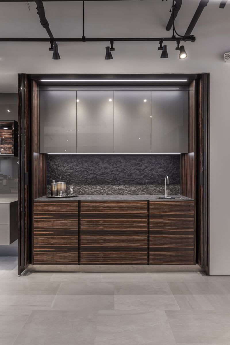 exotic high gloss pocket doors when opened reveal a bar area with sink