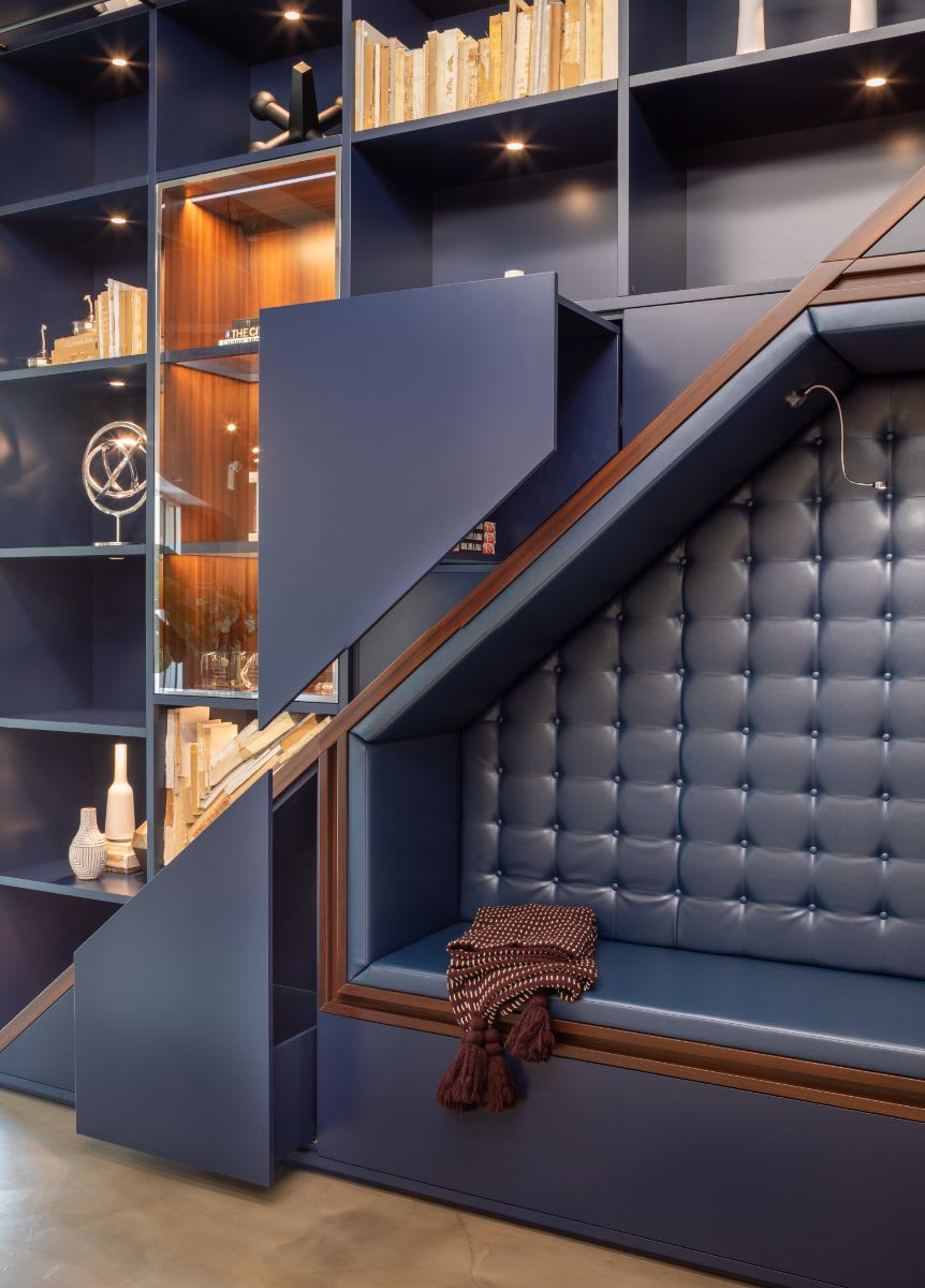 blue tufted leather upholstered seating niche designed by eggersmann using schmalenbach cabinetry components