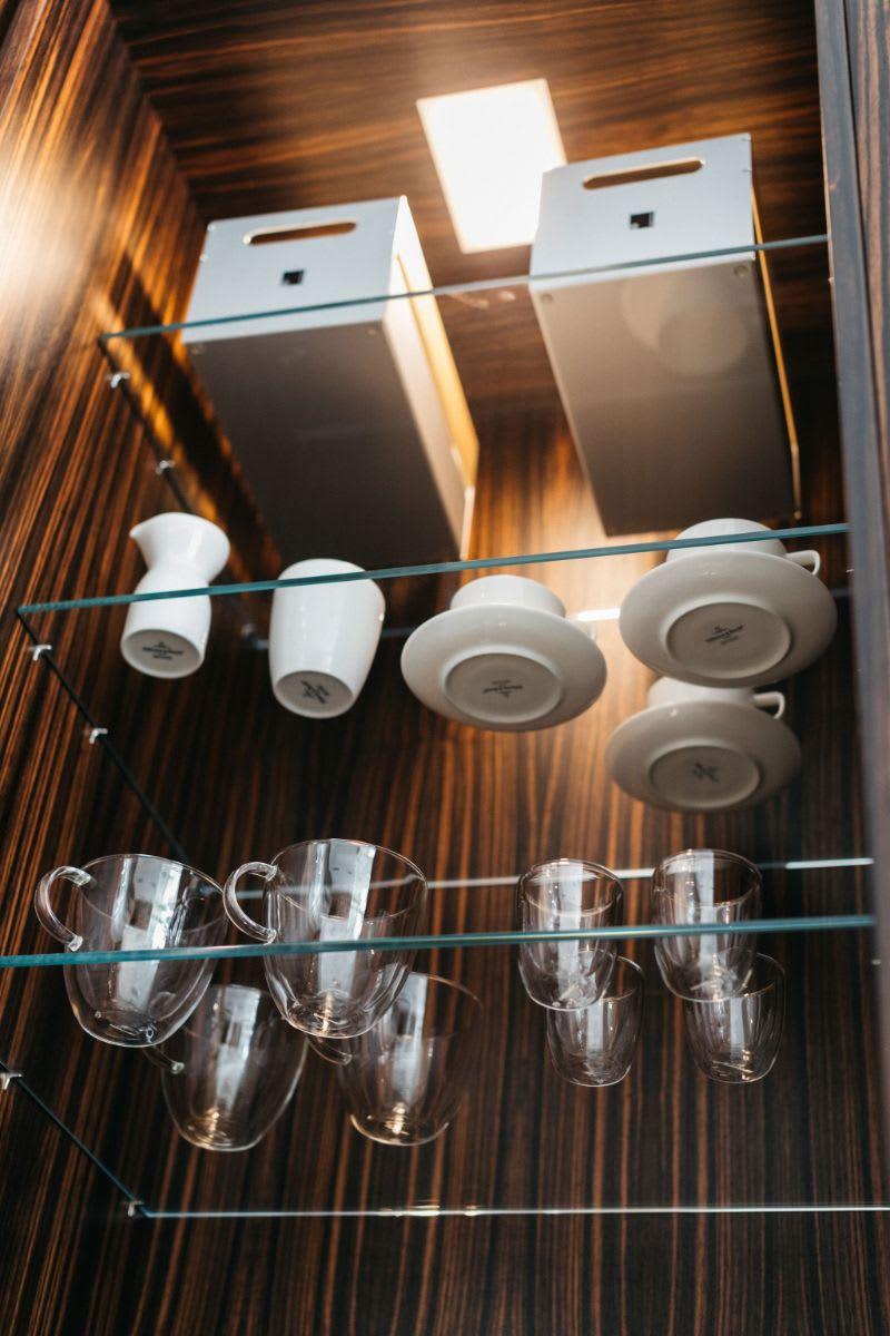 eggersmann BoxTec metal & wood organizing caddy box backlit by LED lighting in a custom coffee bar