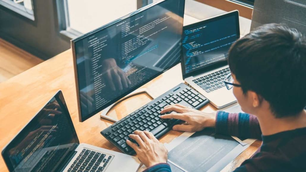 Application developer working on computer