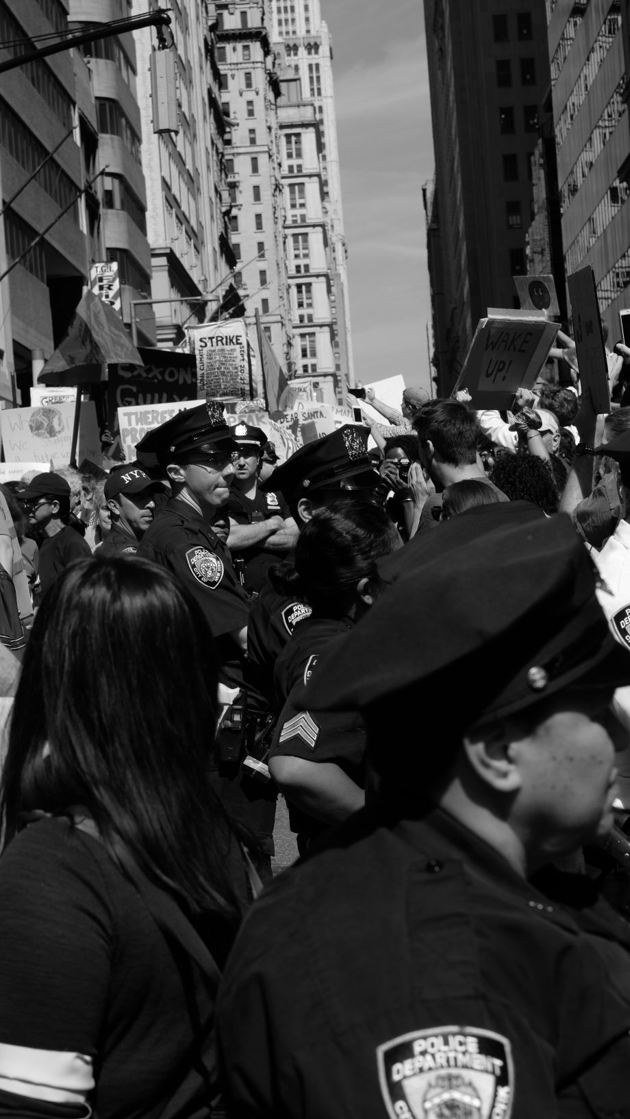 """Wake up!"" – Cops mill around as the march pauses for a moment"
