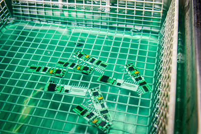 PCBs being cleaned in safewash
