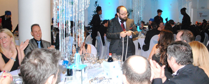 Amusing a group of wedding guests at a dinning table