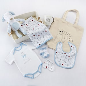 BA11077BL-New Pup 9 Piece Baby Gift Basket-personalized gift set for mom and baby, Baby Aspens New Pup 9-Piece Baby Gift Basket includes a Its been a long day coffee mug for mom along with plenty of goodies for baby! In an adorable puppy theme, the shades of blue and white perfectly accent gift tables at baby boy showers. On the canvas basket, personalized embroidery turns this gift into one that will accent the new ones pup themed nursery! Features and facts:New Pup 9-Piece Baby Gift Basket includes blanket, bib, bodysuit, mittens, socks, pup plush, mug, tote, and canvas bin in a puppy theme.Blanket measures 34w x 0.39d x 34h, Bib measures 9.05w x 0.39d x 11.41h, Bodysuit measures 15.55w x 0.39d x 14.56h, Mittens measure 2.55w x 0.39d x 4.17h, Socks measure 2.75w x 0.39d x 6.10h, Plush measures 6.65w x 4.29d x 13.38h, Mug measures 5.01w x 3.54d x 3.93h, Tote measures 14.50w x 0.78d x 24.05h, Basket measures 19.29w x 9.44d x 3.93h. Packaged set measures 13.5w x 25.5d x 26h.Can be personalized with up to 10 characters of embroid-Blue-