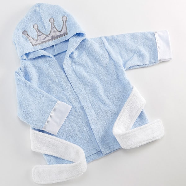 BA14069BL-Little Prince Hooded Spa Robe-personalized with your little ones name. Features and facts:Light blue terry cloth robe features white cuffs and sash, a silver decorative stitch with a silver satin crown appliqueMachine washable 100% cotton terryMeasures 14.6 w x 22 d x 0.4 hPersonalization is available, up to 10 characters; embroidery colors include black, white, navy, grey, fuschia, light blue, light pink, purple, red, silver and gold.-Blue-