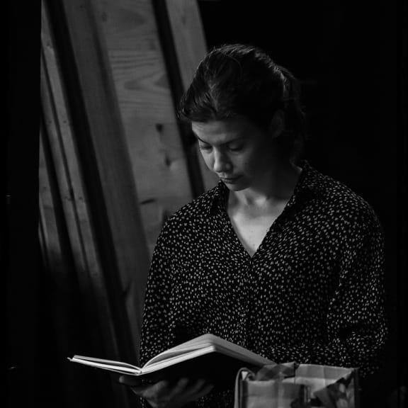 Elisabeth reading her notes.